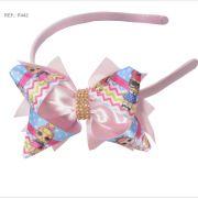 Tiara com laço temático da Lol Surprise rosa bebê