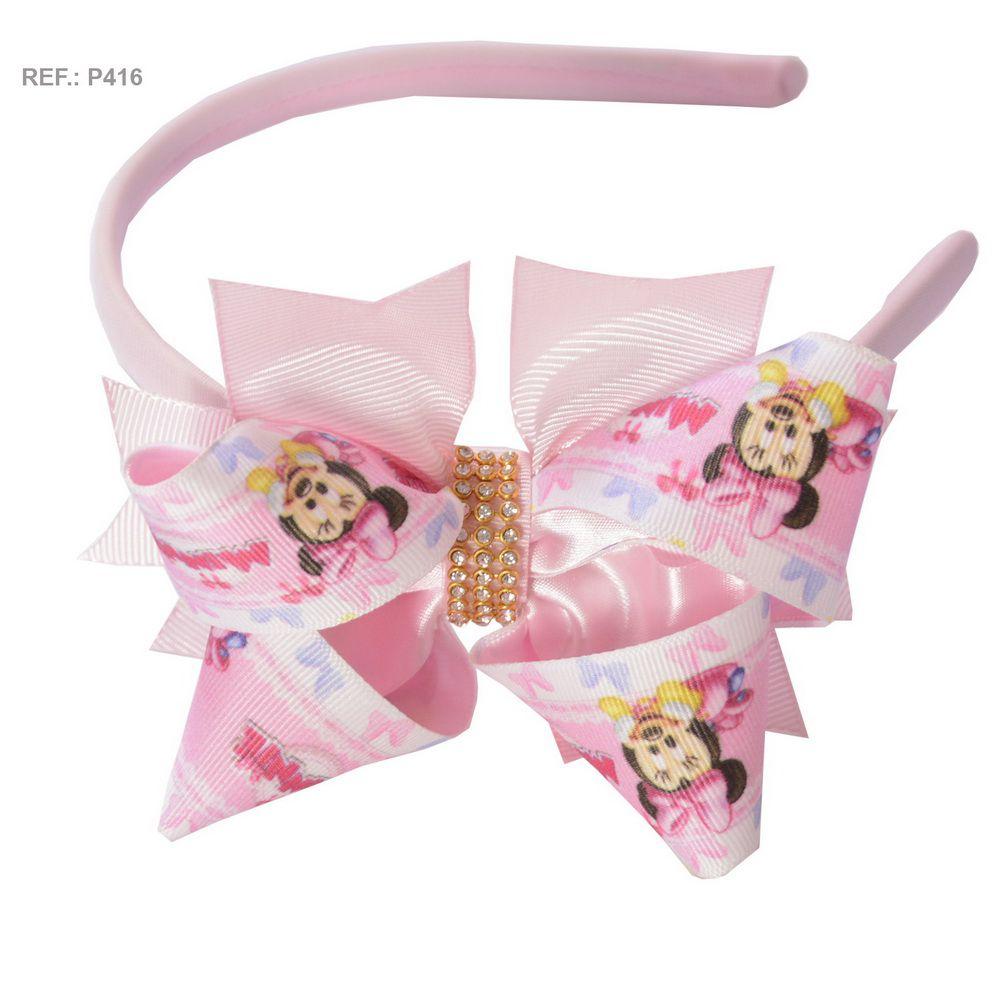 Tiara com laço temático da Minnie rosa bebê