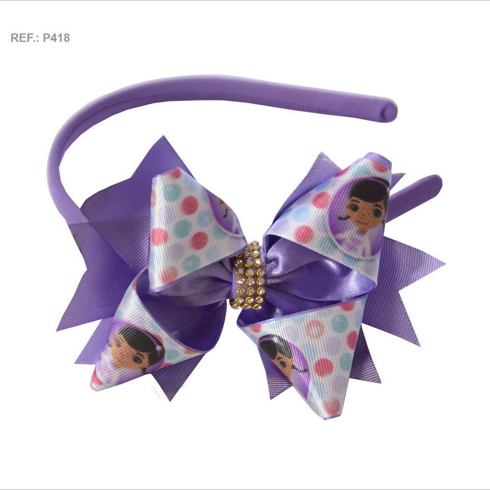 Tiara com laço temático da Doutora Brinquedos lilás