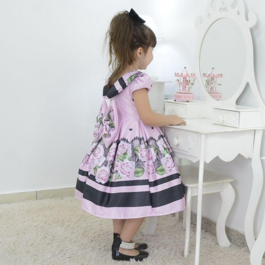 Vestido infantil rosa com preto floral e gola escafandro