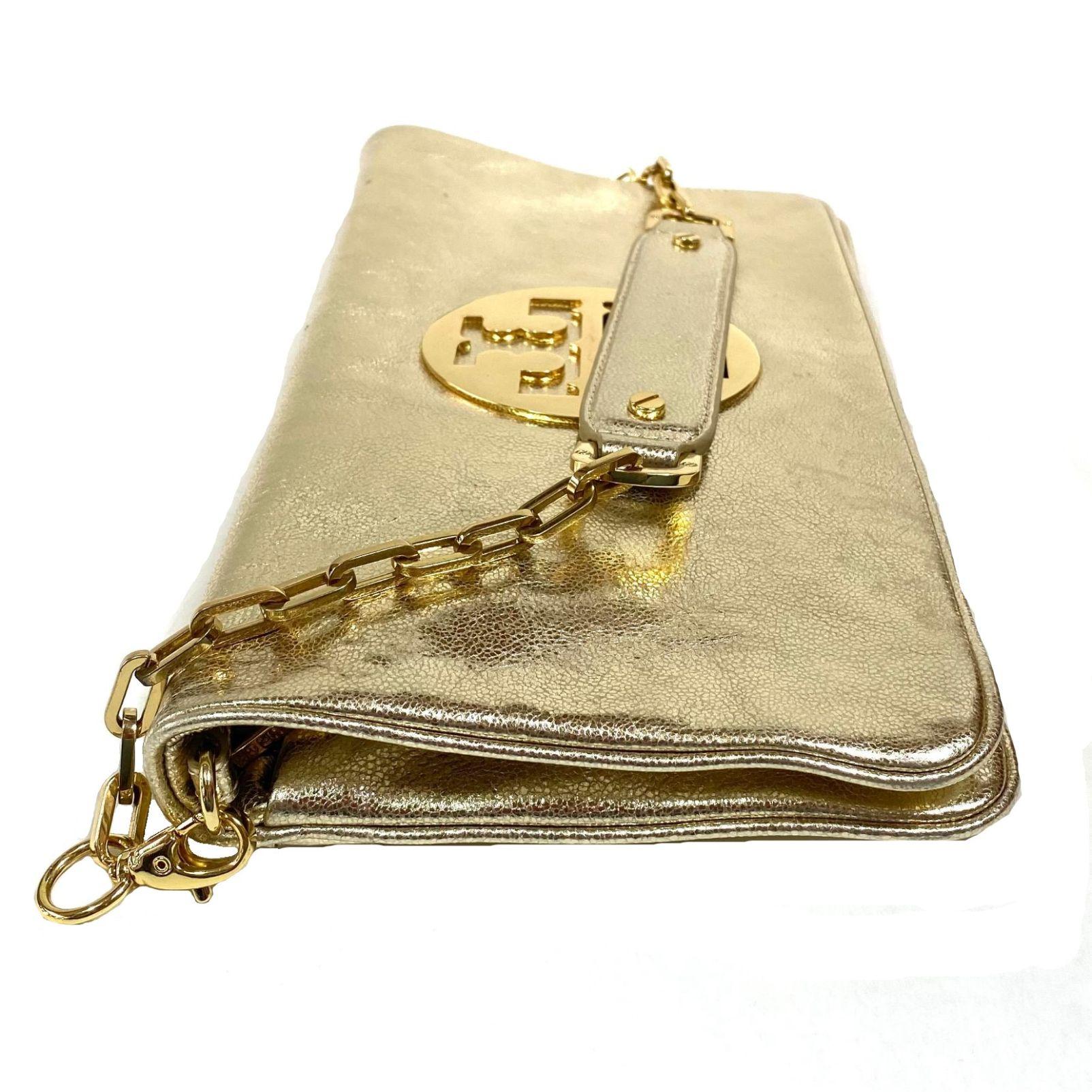 Bolsa Clutch Tory Burch Dourada