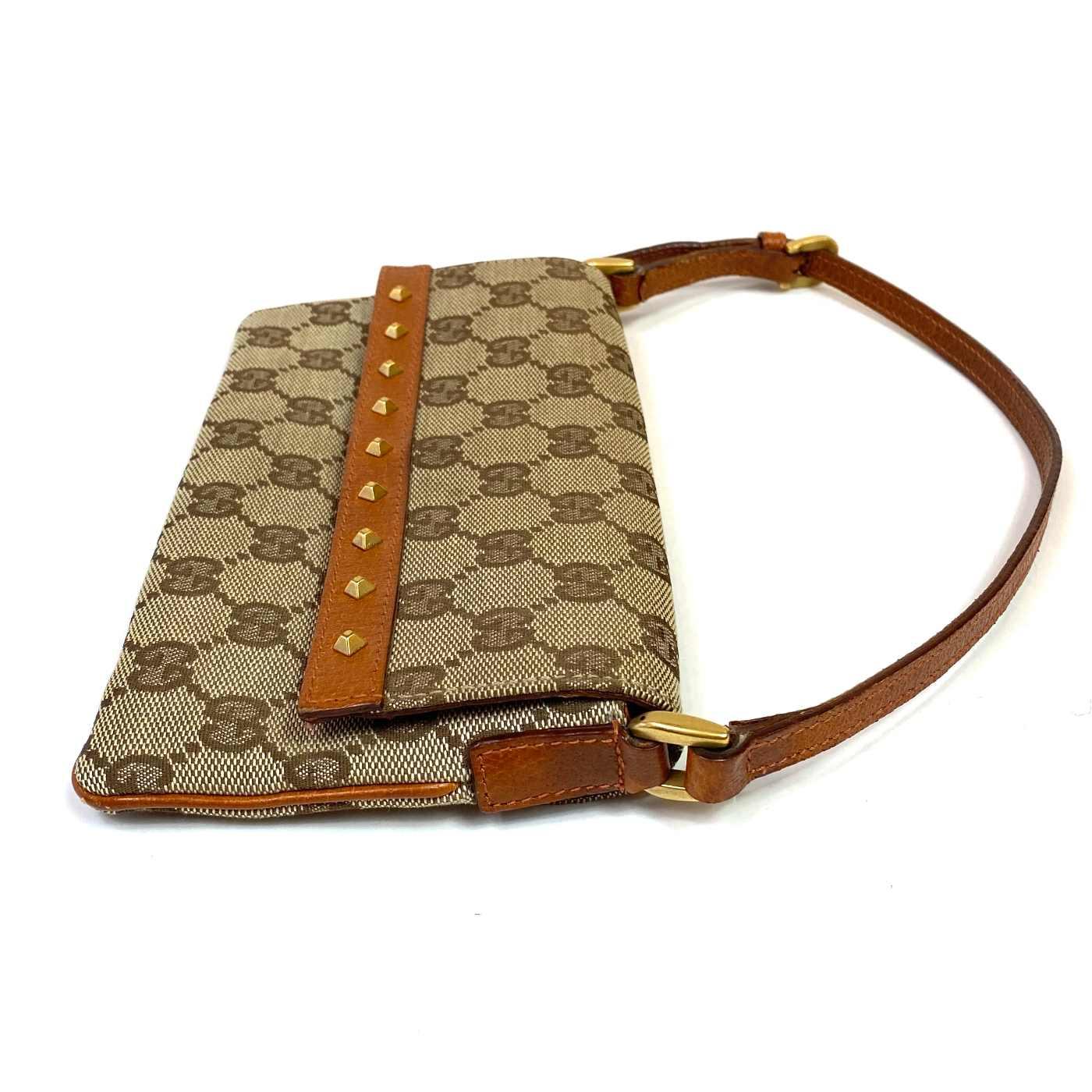 Bolsa Gucci Pochette GG Studded