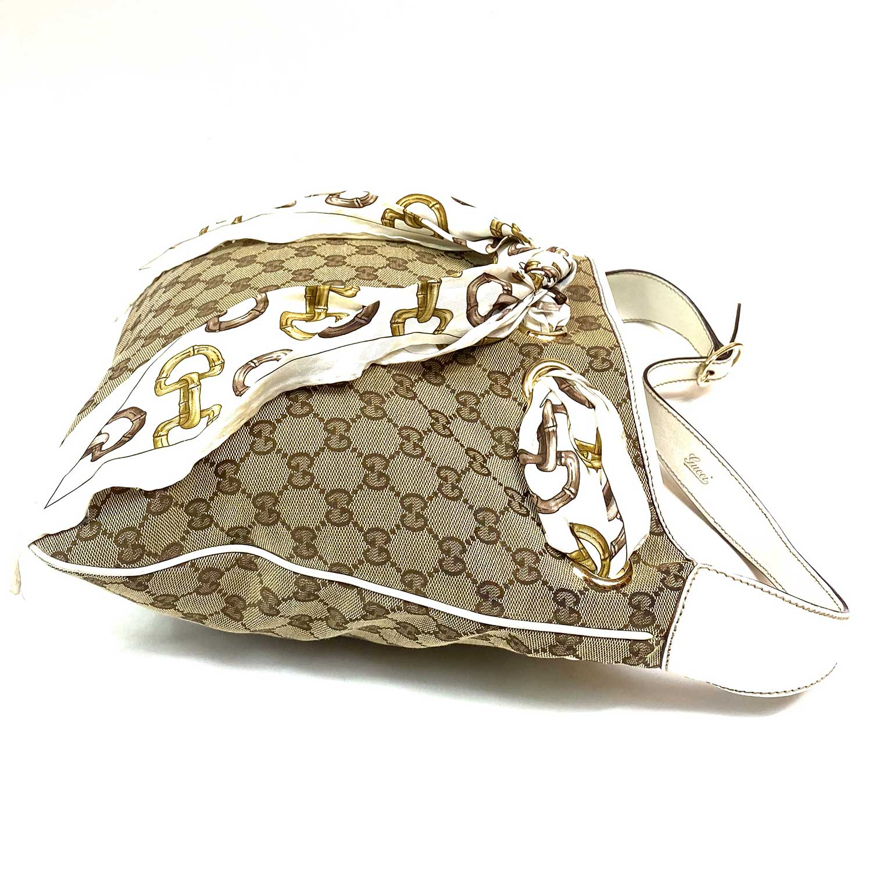Bolsa Gucci Positano Hobo Monograma