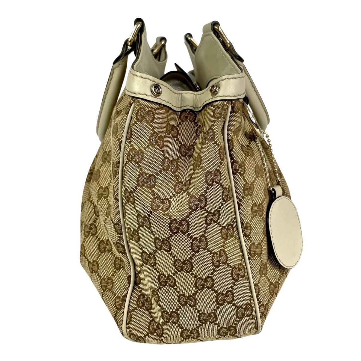 Bolsa Gucci Sukey Medium Monograma