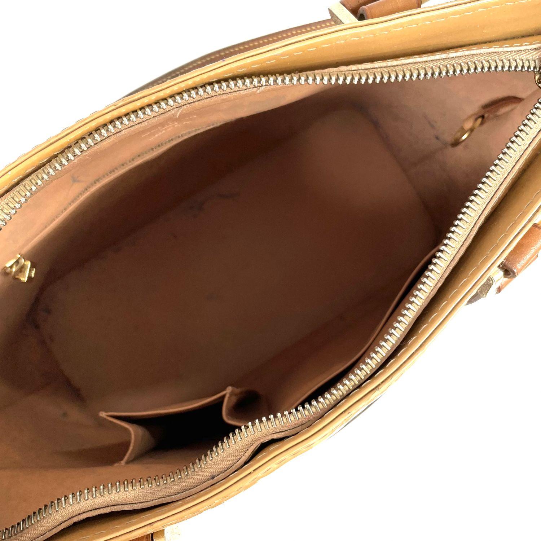 Bolsa Louis Vuitton Houston Verniz