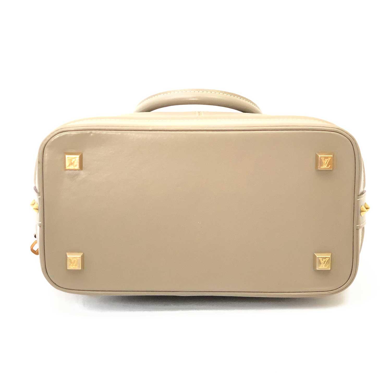 Bolsa Louis Vuitton Lockit Voyage Cinza