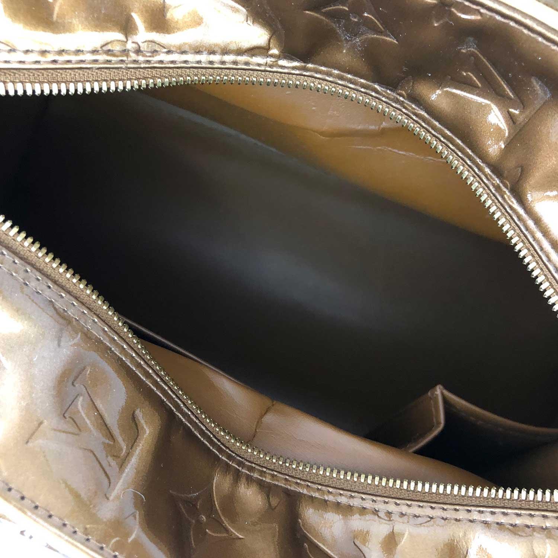 Bolsa Louis Vuitton Tompkins Dourada