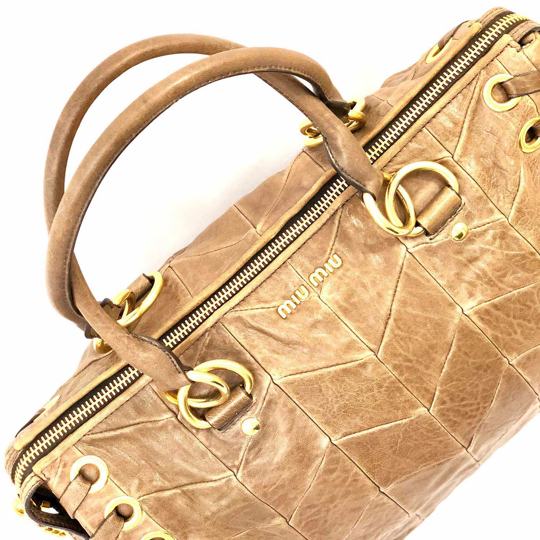 Bolsa Miu Miu Choc Caramelo com Ilhós Dourado