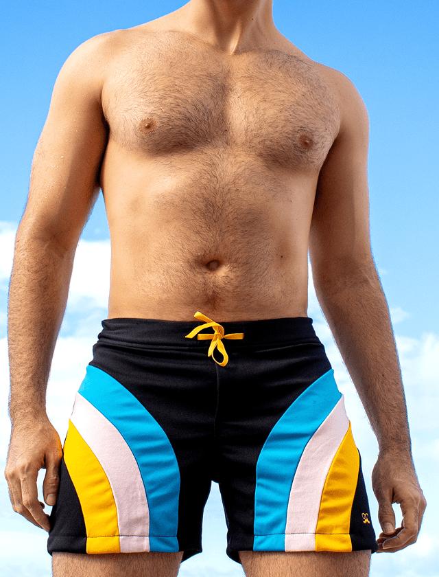 Short preto com recortes azul, rosa e amarelo