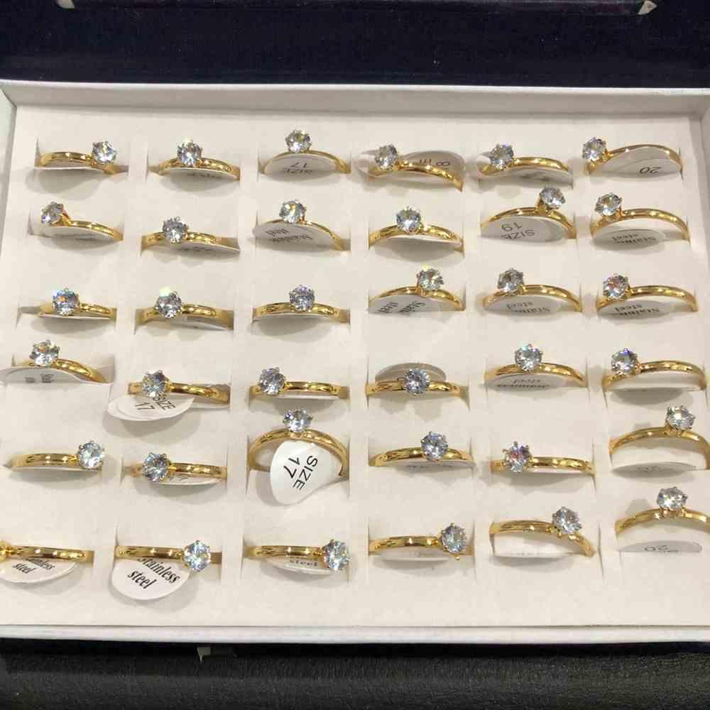 Anel solitário 2mm dourado com pedrarias prata aço inoxidável 316L caixa com 36 unidades