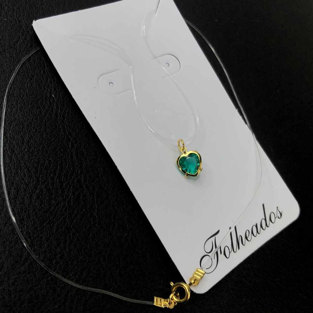 Colar ponto de luz prata fio de nylon folheado coração verde esmeralda