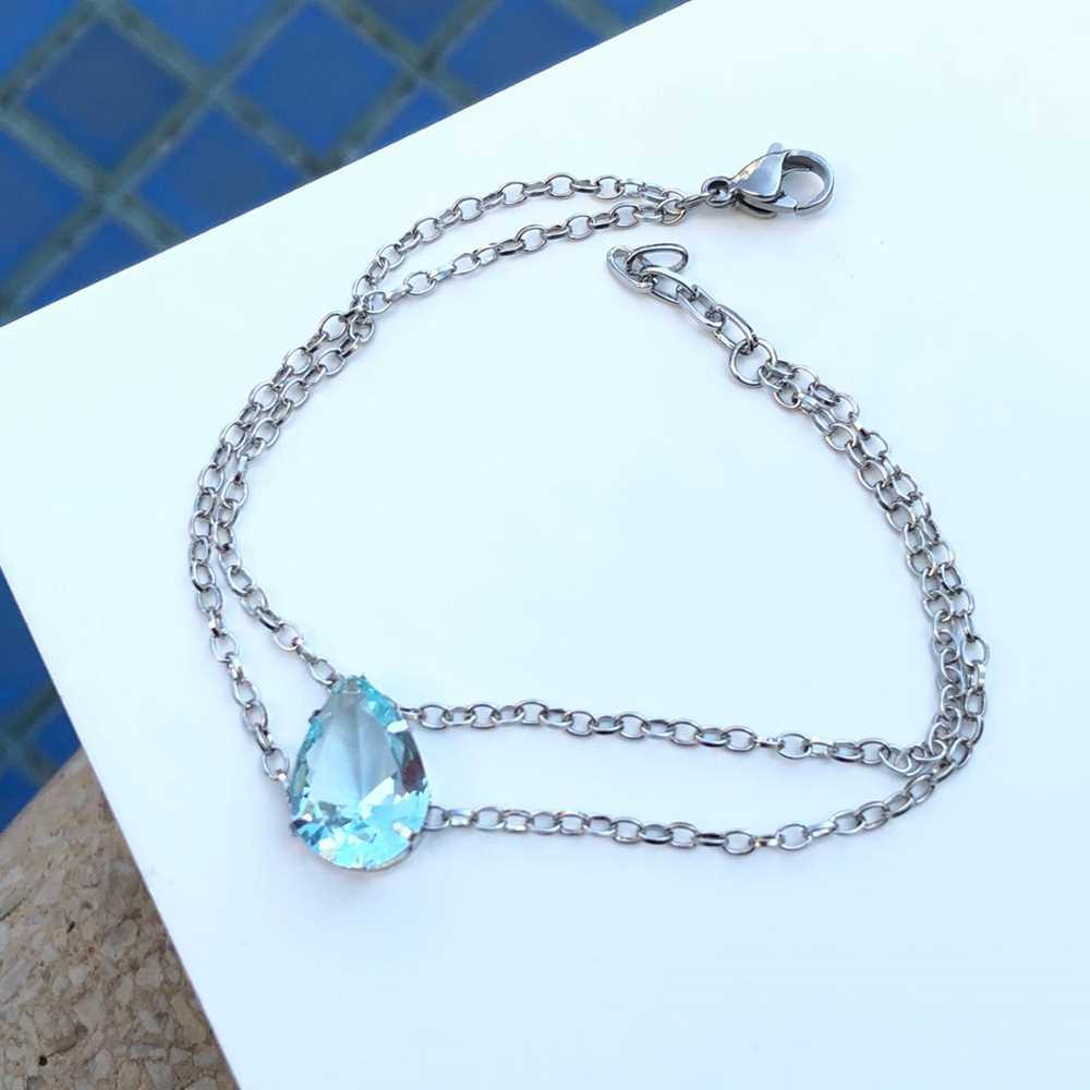 Pulseira de aço feminina dupla pingente pedra gota azul bebê