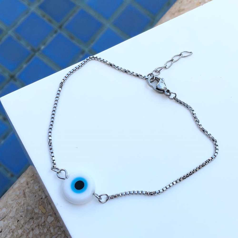 Pulseira de aço feminina pingente olho grego branco