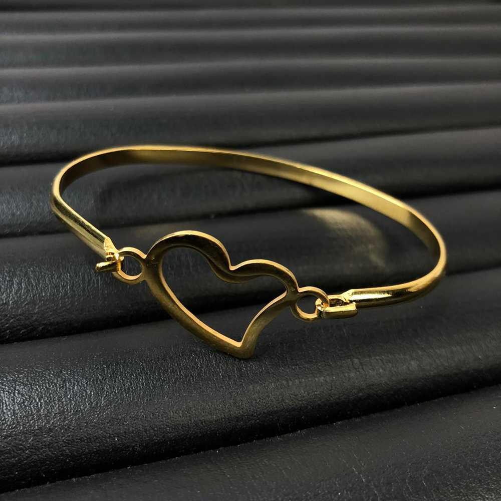 Pulseira feminina bracelete feminino em aço inoxidavel dourado coração vazado