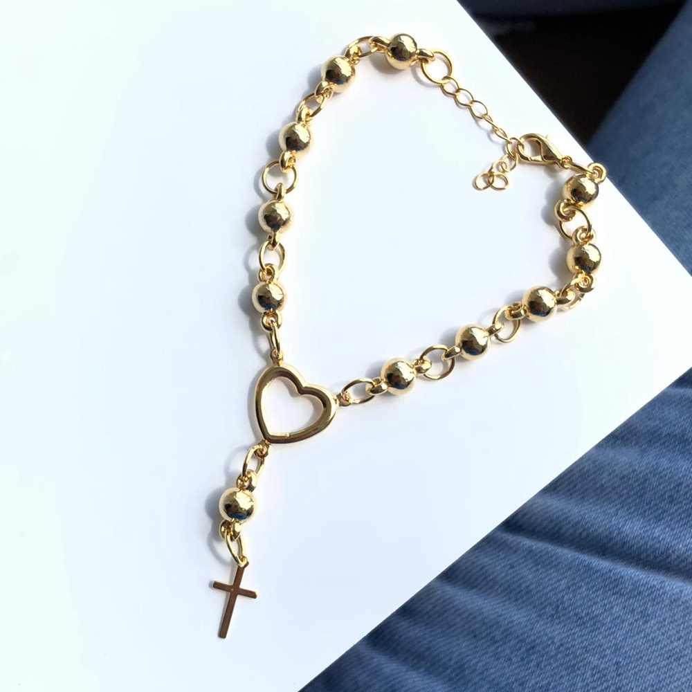 Pulseira folheada a ouro miçanguinhas esferas dourada coração e cruz