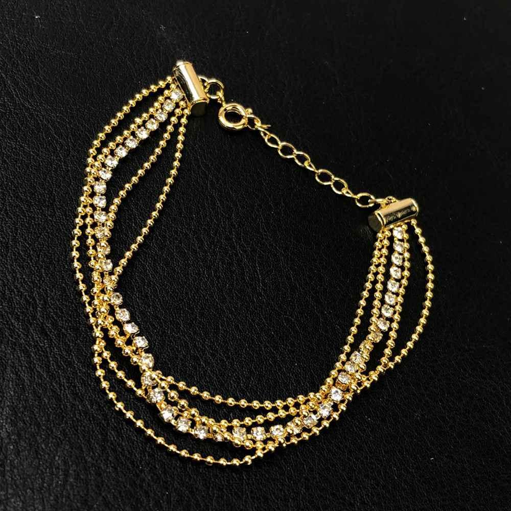 Pulseira folheada a ouro mix de fios com pedrarias strass prata