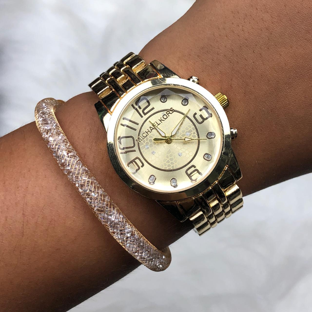 d2f691bebf8 Relógio Feminino Dourado + Pulseira Solitária Pedrarias - Diamante ...