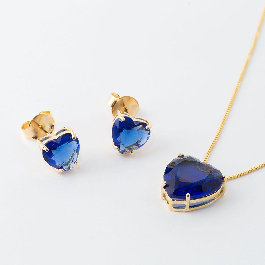 Conjunto Coração Grande em Cristal Azul Safira translúcido com banho em Ouro Amarelo
