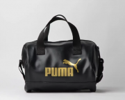 BOLSA PUMA WMN CORE UP HANDBAG PRETO OURO - Original