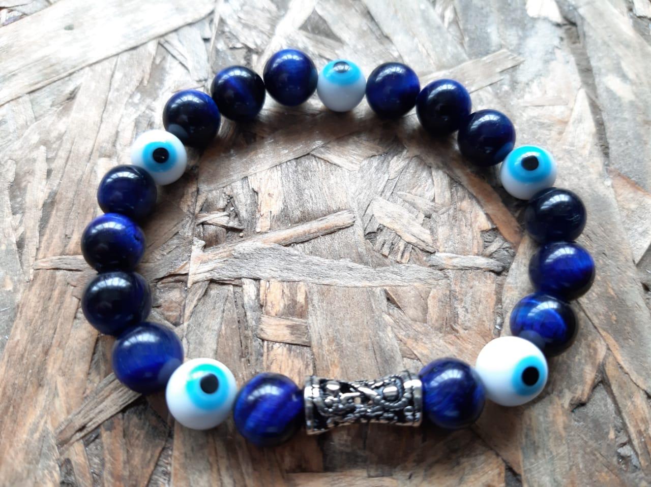 Pulseira  Pedra Natural Olho de Tigre Azul com Olho Grego em Murano e Arabesco Prateado