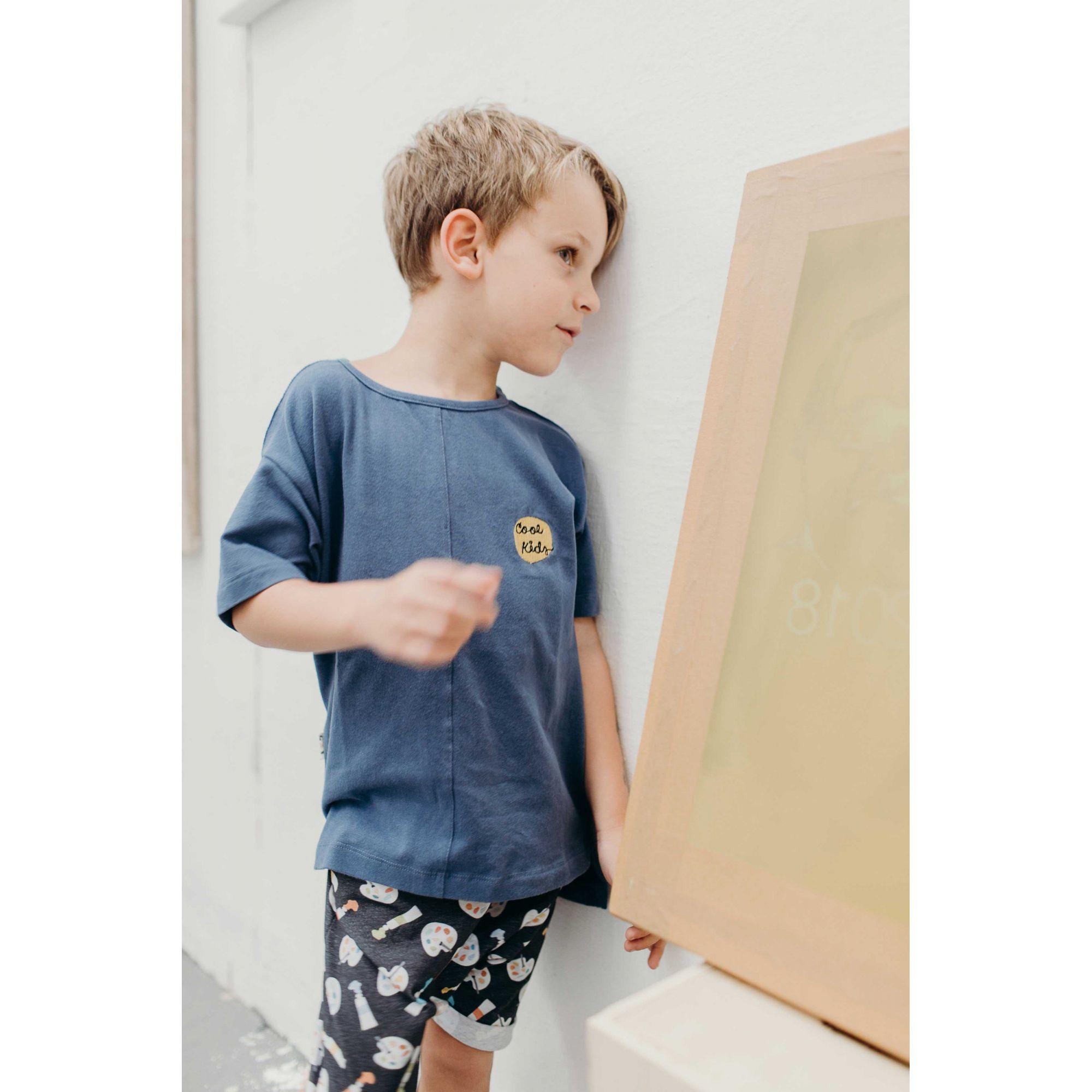 Camiseta infantil recortes azul