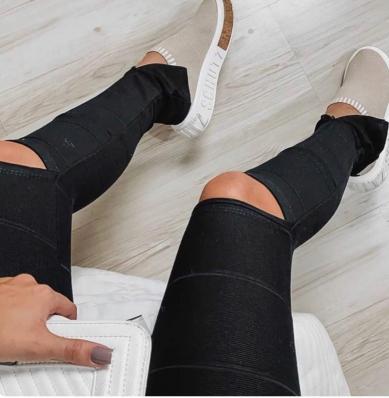 Calça Feminina Bandagem com Rasgo no Joelho