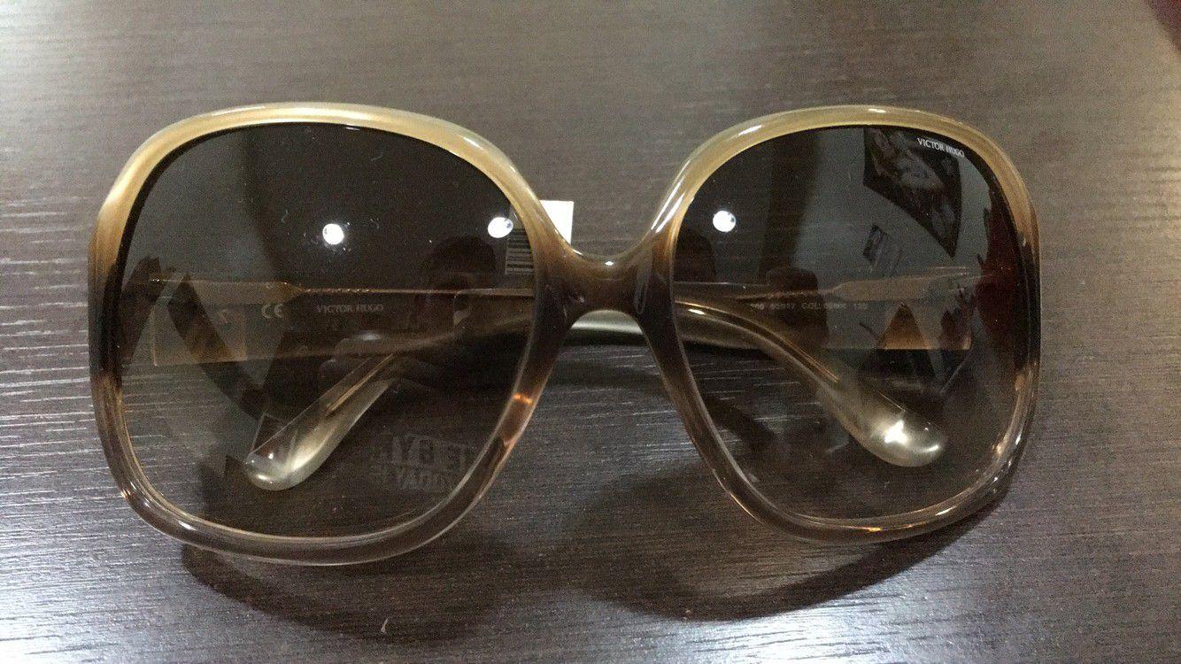 1743e6594 Óculos de Sol Victor Hugo sh1609 60 17 col.09mk - Omega Ótica e ...