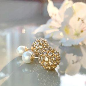 Brinco semijoia inspiração Dior esfera vazada com zirconias 137226