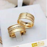 Aliança trabalhada de ouro  Peso 13 gramas  Largura 6,5mm - WM10044