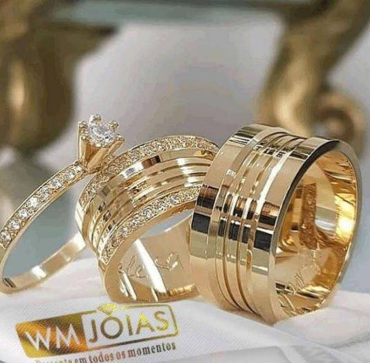 Alianças de casamento  mais anel solitário  Peso 22 gramas o par Largura 9 mm- WM10084
