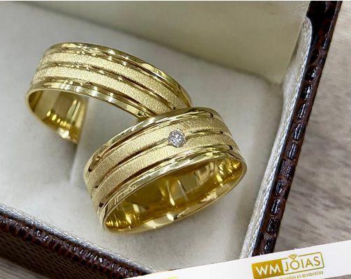 Alianças ouro amarelo 18k  Peso 12 gramas  Largura 7mm- WM10222