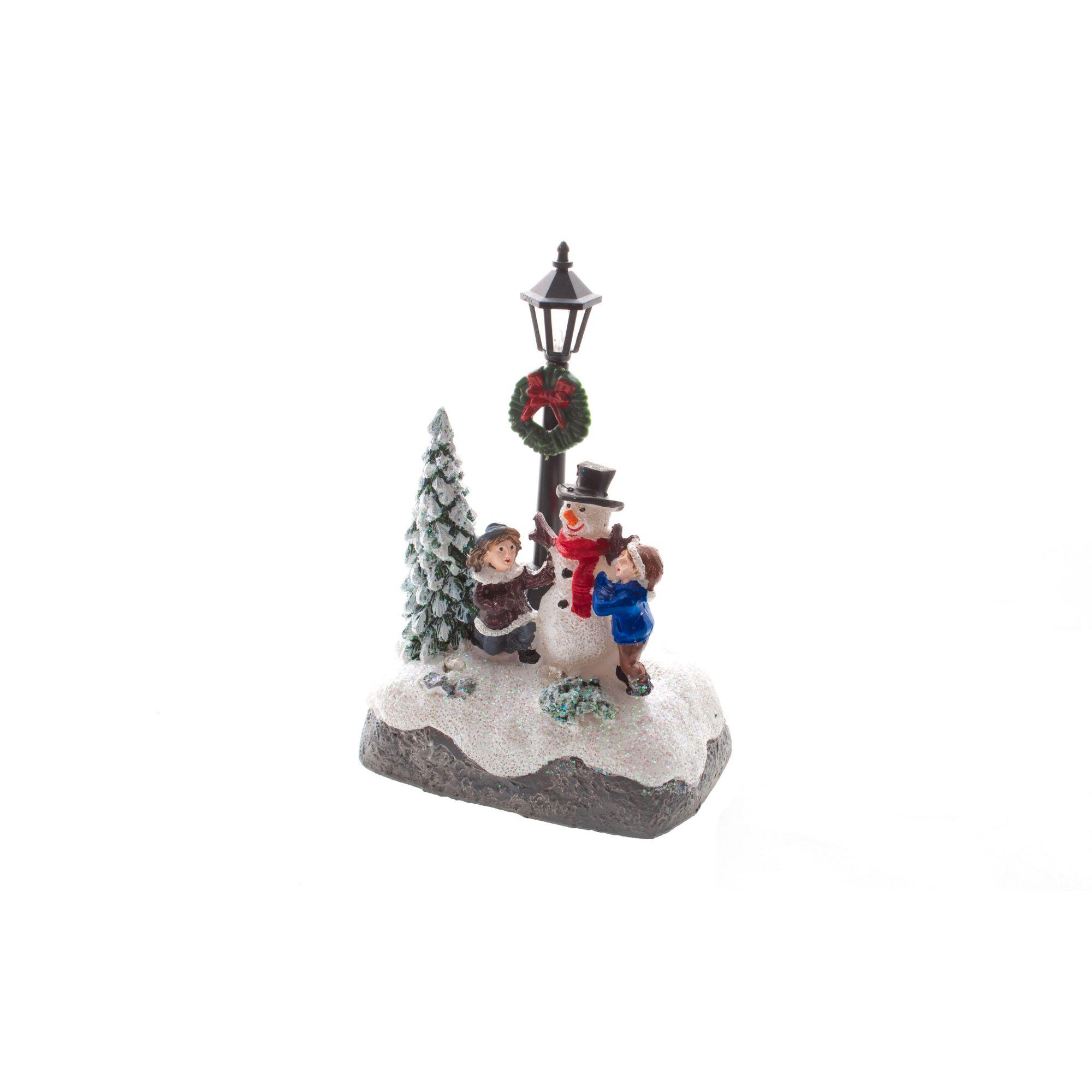 Mini estátua crianças na neve