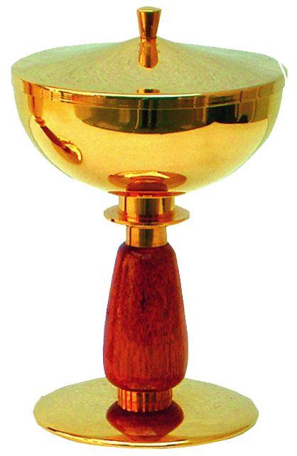 Cibório com detalhe de madeira - dourado ou niquelado - altura 20cm - diâmetro da copa 12cm - capacidade para 300 partículas