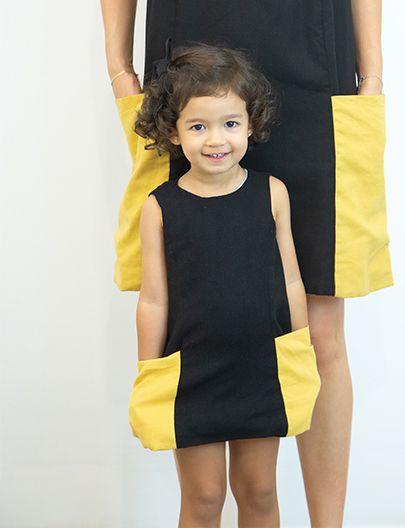 vestido bolsão preto/mostarda