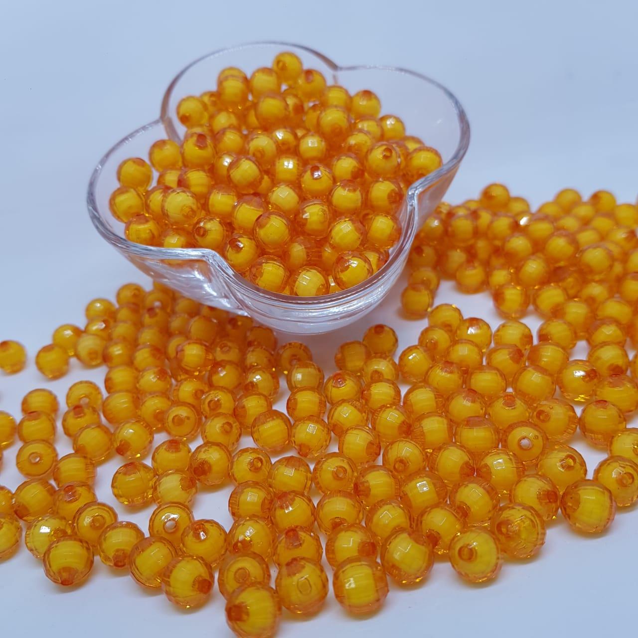 Bolinha de acrilico laranja com miolo branco facetado 10MM 25g