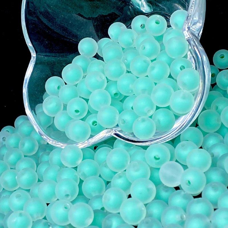 Bolinha de acrilico transparente com miolo verde  10MM 25g