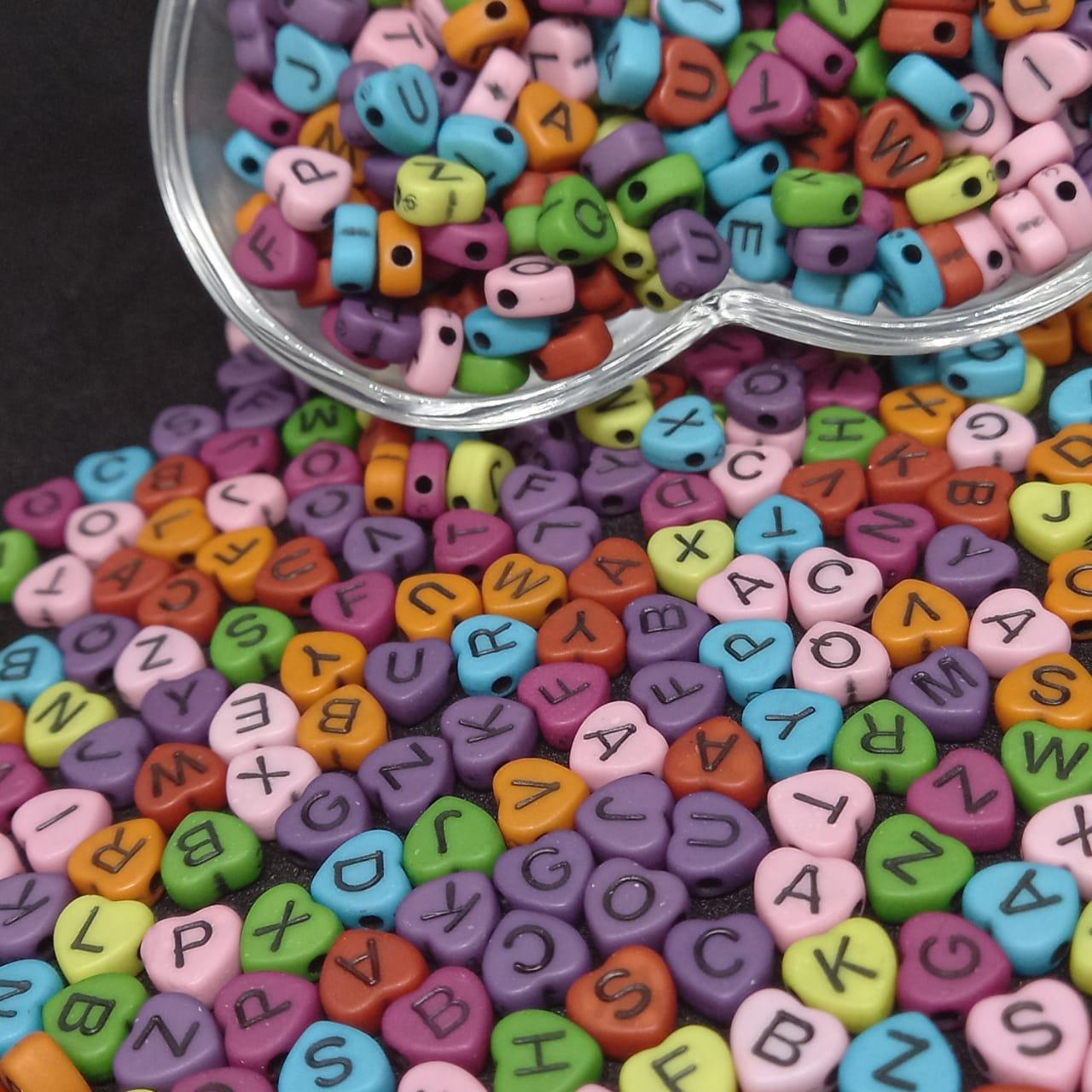 Coração multicolor c/ letra preta 7mm- 25g
