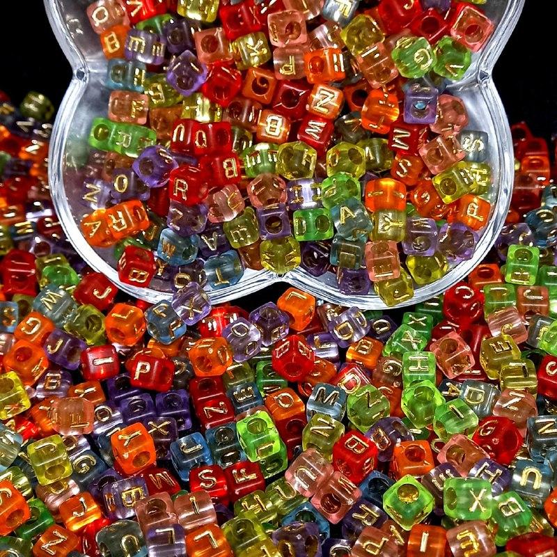 Cubo multicolor transparente c/ letras douradas - 25g 6mm