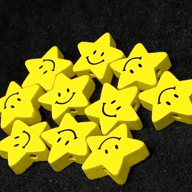 Entremeio de estrela feliz amarela 18x19mm / unidade
