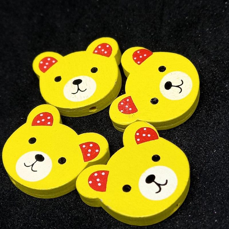 Entremeio rosto de ursinho amarelo c/ vermelho 21x24mm /unidade