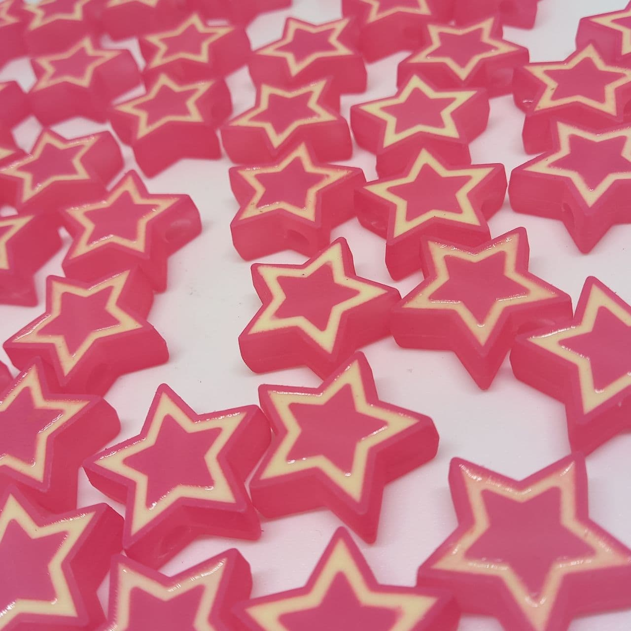 Estrela c/ furo passante rosa 23 mm- unidade