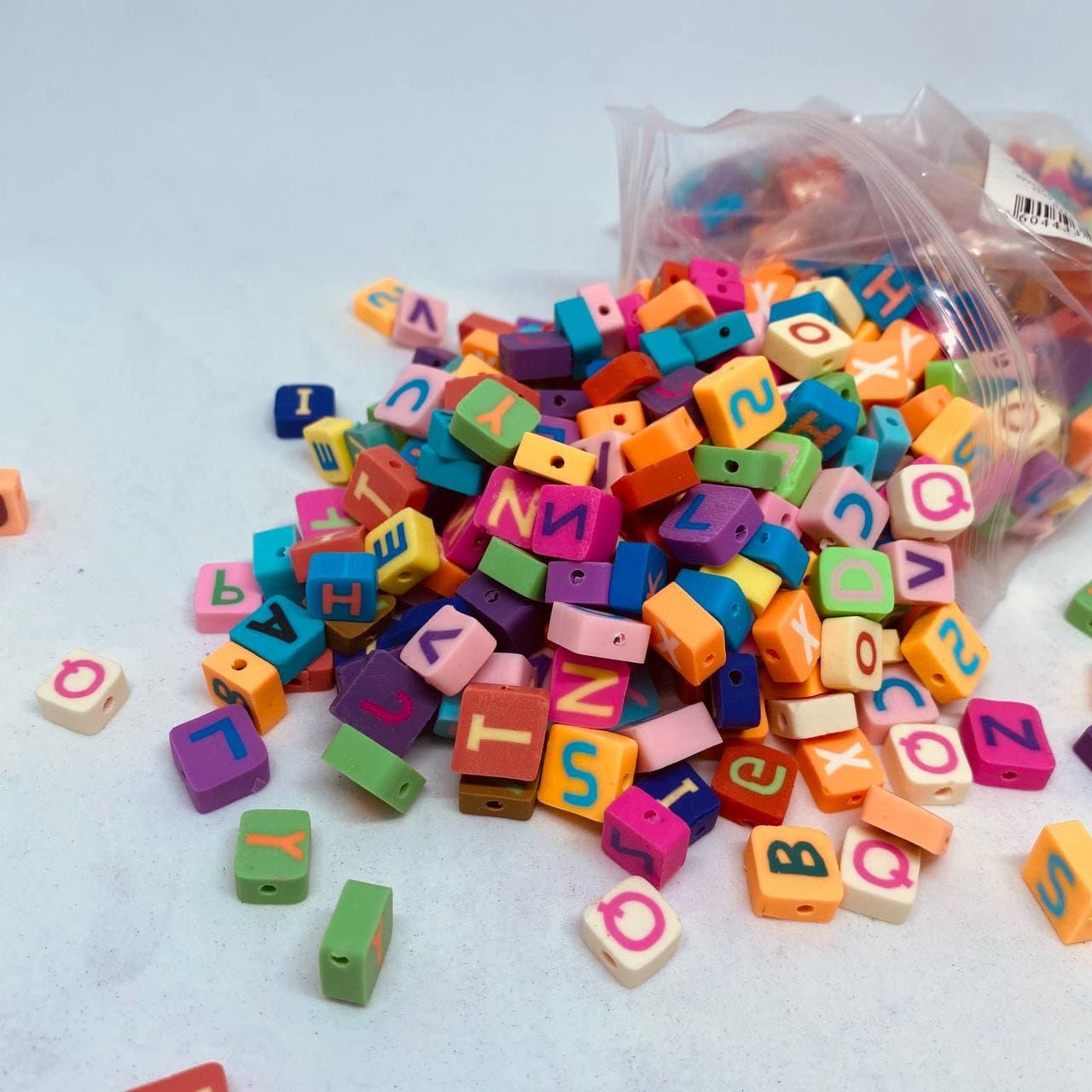 Miçanga Letrinhas Coloridas emborrachada10x5mm  pacote com 10g  - Palácio Dos Cristais