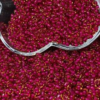 Miçangão dourada transparente com miolo rosa   4.1mm (6/0) 25g