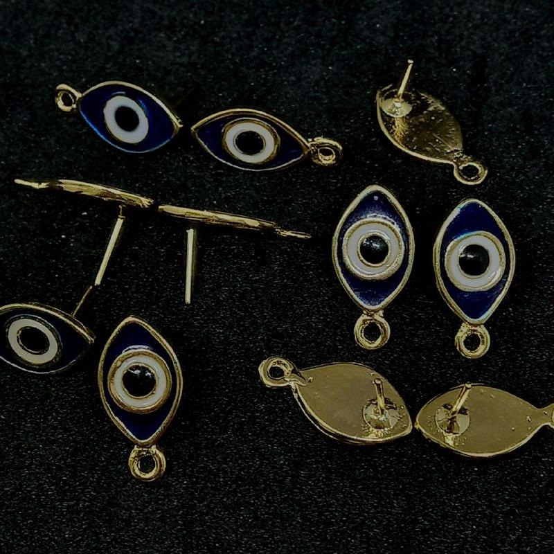 Pino  para brinco dourado  olho grego azul escuro  c/ branco 20x10mm