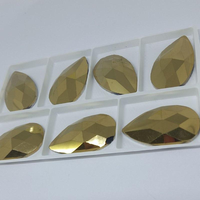 Pedra de vidro gota Dourado 22x38 / unidade