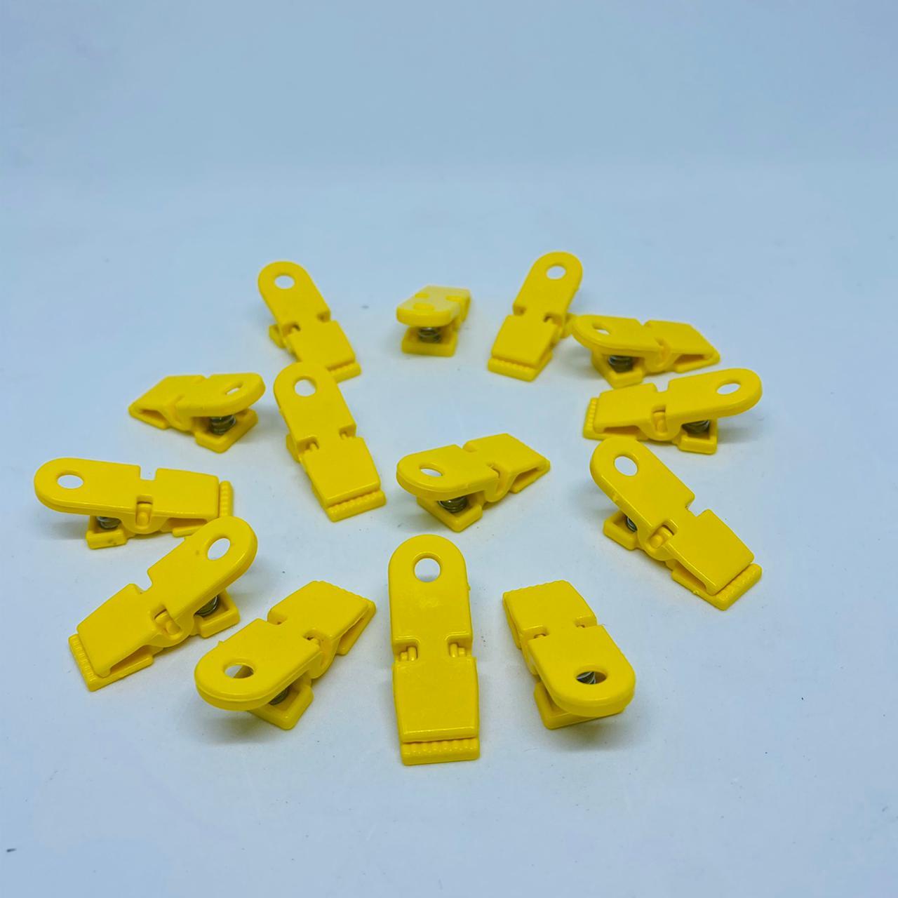 Prendedor de chupeta amarelo