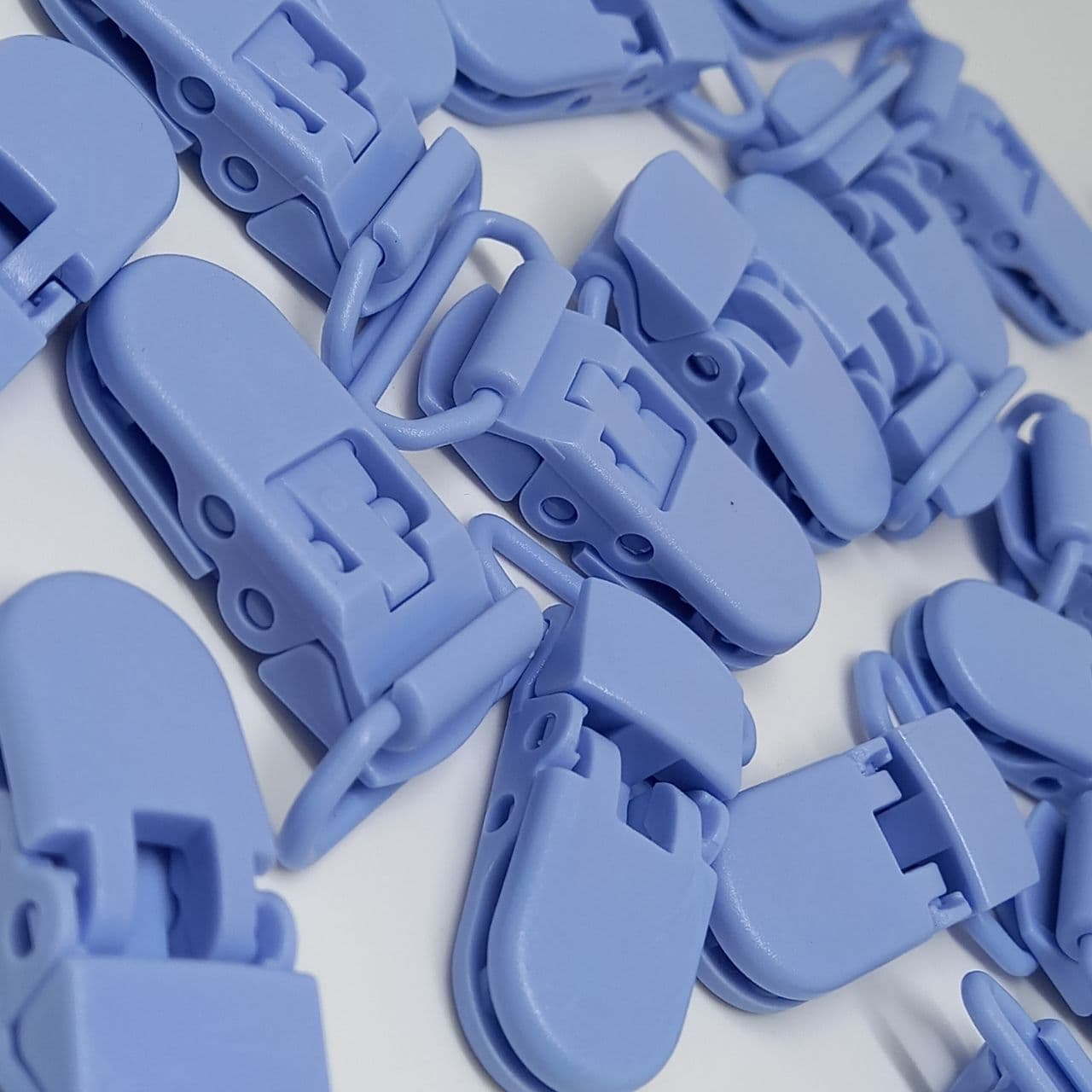 Prendedor de chupeta boca de jacaré azul caribe  38x9mm / unidade