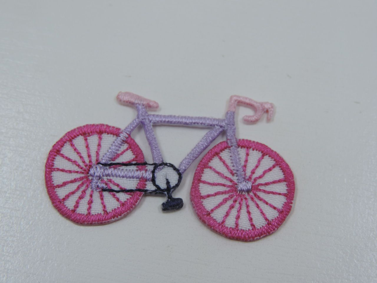 aplique termocolante bicicleta 4,8x2,8cm unitário