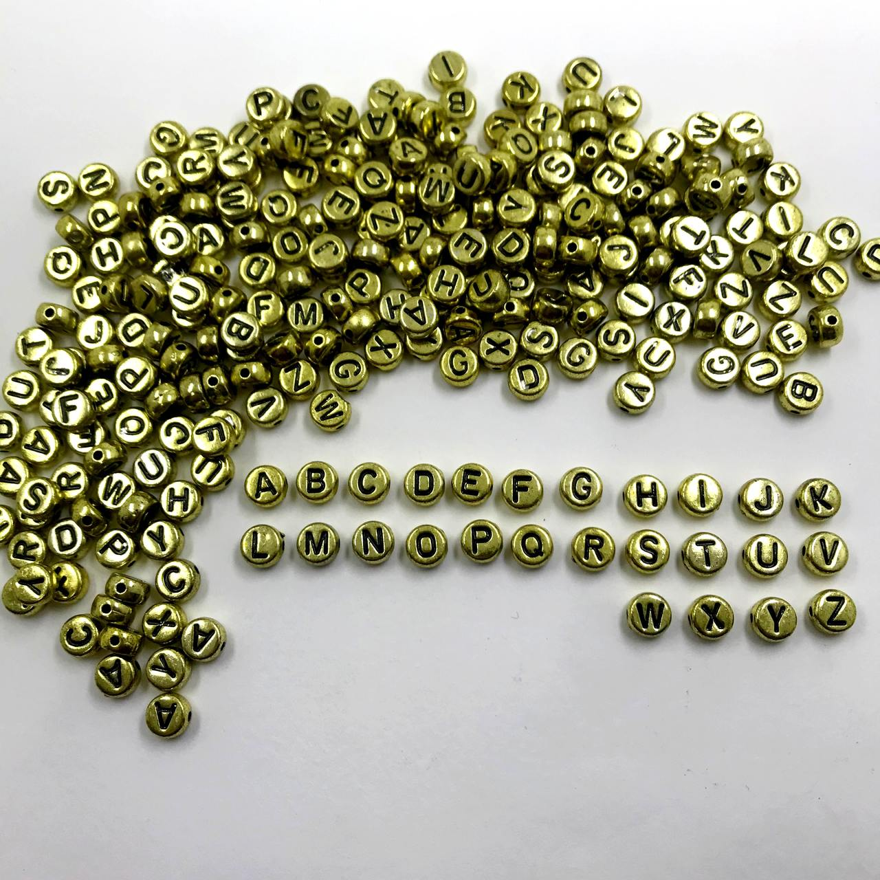 entremeio oval letras alfabeto com furo 6mm 200 unidades