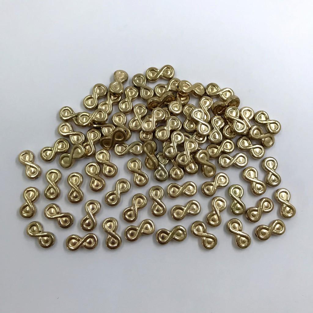 entremeio símbolo do infinito dourado com furo 12x6mm 12 unidades